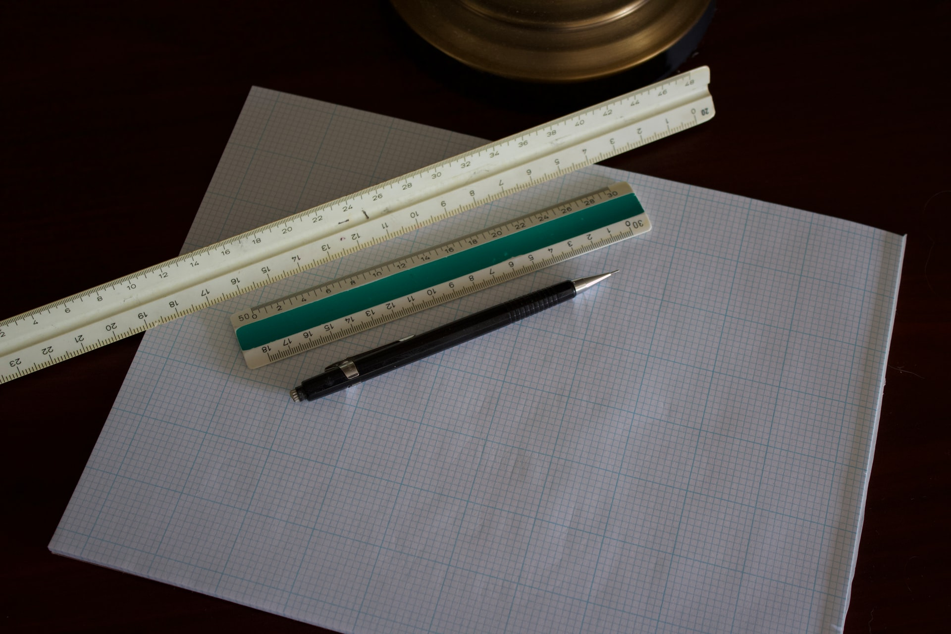 Graph paper, rulers, and a pen