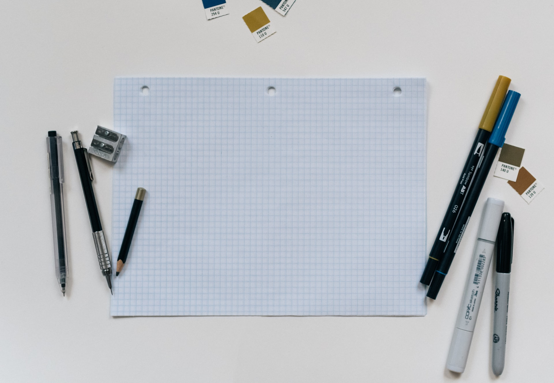 Graph paper, pens, and Sharpies